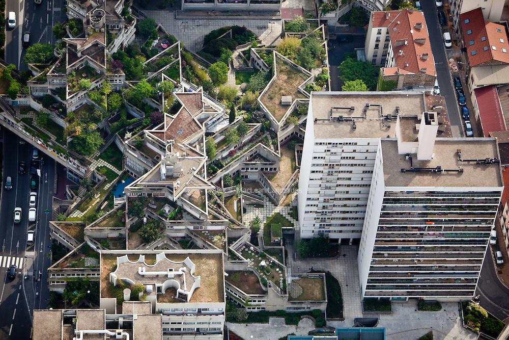 Ivry-sur-Seine, département du Val-de-Marne (94), centre-ville, multi level overpass with roof decks contrast with conventional highrise apartment buildings.