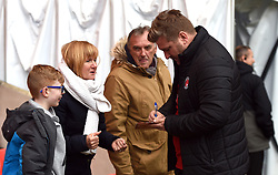 Charlton Athletic manager Karl Robinson signing autographs for supporters prior to kick-off