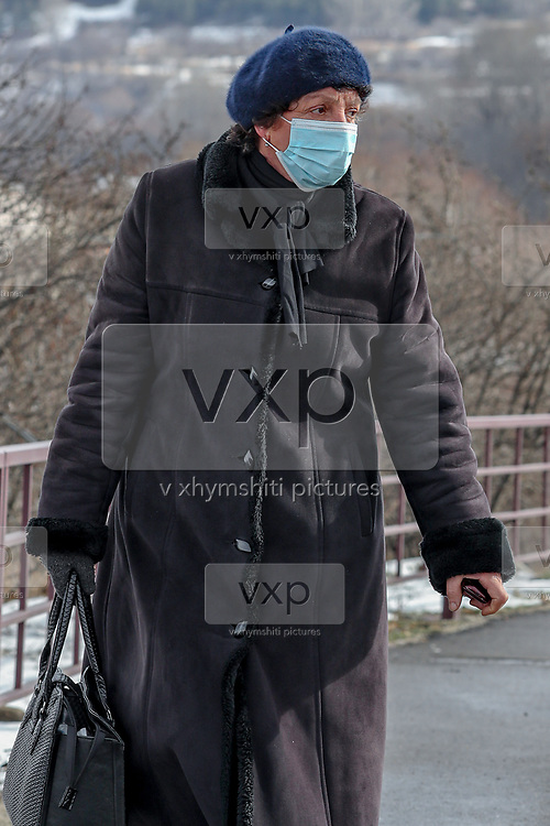 A lady wearing a face protective mask to curb the spread of coronavirus pandemic outbreak, with a soviet style winter outfit, walks along a Bridge that connects ruined city with newly rebuilt Spitak. The Rubble left by the Earthquake which struck 33 years are still visible. On Sunday, Jan 16, 2021, I visited the city which lies close to the epicentre of 1988 devastating Armenia quake, some 100 km (62 miles) north of the capital Yerevan. Spitak was entirely destroyed during the devastating earthquake, which is now rebuilt in a slightly different location. The earthquake that devastated Armenia in December 1988 killed 25,000 people and leaving half a million homeless. Like the tsunami that devastated southern Asia 16 years later, it focused the world's sympathy for unspeakable suffering and unleashed an outpouring of aid. (Photo/ Vudi Xhymshiti)