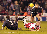 Photo Pete Downing<br />Sheffield Utd V Burnley.<br />Nationwide division one.<br /> 8/11/ 2003.<br />Chris Armstrong takes a tumble for Sheffield with Mo Camara.<br /><br /><br />Photo:Peter Downing