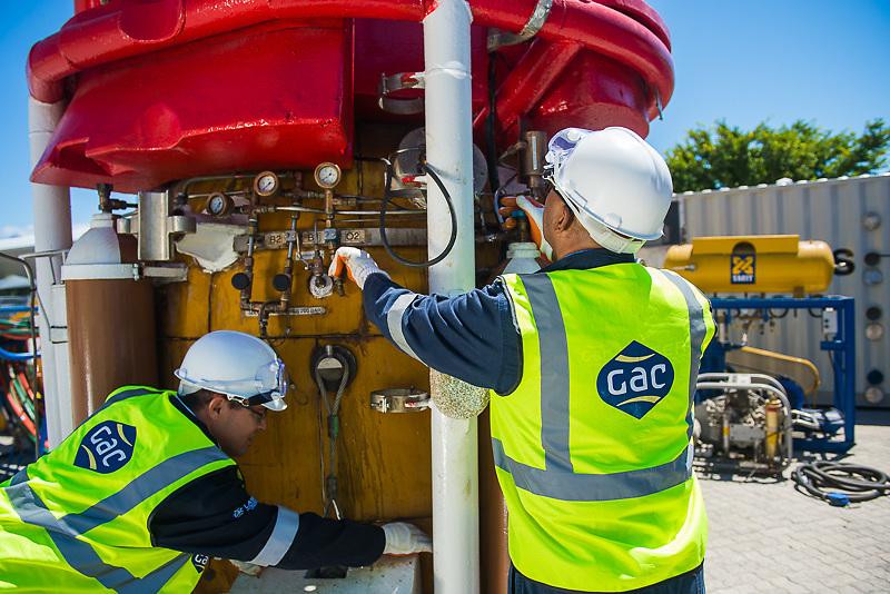 GAC Employees checking equipment