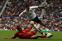 Photo: Paul Thomas.<br /> England v Macedonia. UEFA European Championships 2008 Qualifying. 07/10/2006.<br /> <br /> Stewart Downing (R) of England jumps to advoid the tackle of Vlade Lazarevski.