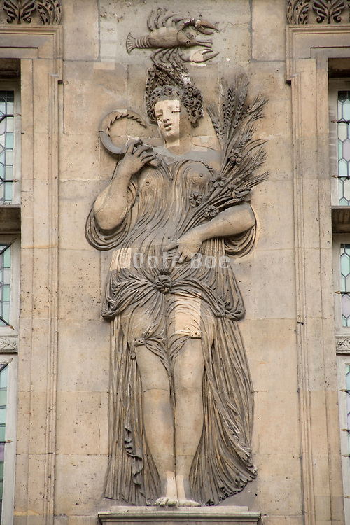 a repaired symbolic bas relief on a old building in Paris