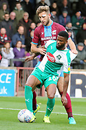 Scunthorpe United defender Charlie Goode (20) and Plymouth Argyll midfielder Joel Grant (16) battle for the ball  during the EFL Sky Bet League 1 match between Scunthorpe United and Plymouth Argyle at Glanford Park, Scunthorpe, England on 27 October 2018. Pic Mick Atkins