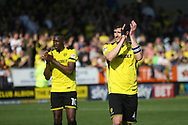 Burton Albions captain John Moushino and Lucas Akins celebrate after the final whistle during the EFL Sky Bet Championship match between Burton Albion and Leeds United at the Pirelli Stadium, Burton upon Trent, England on 22 April 2017. Photo by John Potts.
