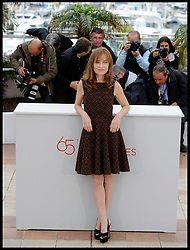 Isabelle Huppert pose's for Photographers during the Photocall for the film In Another Country during 65th Annual Cannes Film Festival at Palais des Festivals, Cannes, France, Monday May 21, 2012. Photo by Andrew Parsons/i-Images.