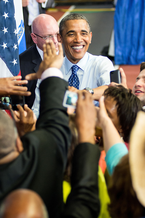 President Obama greets the crowd at the Reggie Lewis Center in Roxbury, MA.