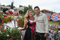 06.10.2013, Kaefers Wiesenschaenke, Muenchen, GER, der FC Bayern Muenchen beim Oktoberfest, im Bild Claudia Pizarro of Bayern Muenchen poses with Karla Salcedo in front of the ensemble of the Bavaria statue, a monumental bronze sand-cast 19th-century statue and the Hall of Fame (Ruhmeshalle). The Bavaria is the female personification of the Bavarian homeland and by extension its strength and glory // during the Oktoberfest 2013 beer festival at Kaefers Wiesenschaenke in Munich, Germany on 2013/10/06. EXPA Pictures © 2013, PhotoCredit: EXPA/ Eibner/ Eckhard Eibner<br /> <br /> ***** ATTENTION - OUT OF GER *****