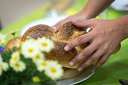 15 March 2019, Jerusalem: Rabbi Tamara Schagas blesses the two loaves of bread traditionally served at a Shabbat dinner.  On 15 March, a group of Ecumenical accompaniers from the World Council of Churches were invited to share Shabbat dinner with the Kol HaNeshama congregation in Jerusalem. Kol HaNeshama is a reformed Jewish congregation of 350 families in Jerusalem, and one that works actively to be a focal point for Jewish pluralism and social action in the area.