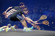 a multiple exposure image of Mathieu Castagnet of France as he plays a shot against Omar Mosaad of Egypt in the final.  the Final, Omar Mosaad of Egypt v Mathieu Castagnet of France , Canary Wharf Squash Classic 2016 , at the East Wintergarden in Canary Wharf , London on Friday 11th March 2016.<br /> pic by John Patrick Fletcher, Andrew Orchard sports photography.