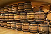 Wooden barrels for aging wine in the cellar of Guigal in Ampuis. The barrels are old and will be replaced and sold.  Domaine E Guigal, Ampuis, Cote Rotie, Rhone, France, Europe