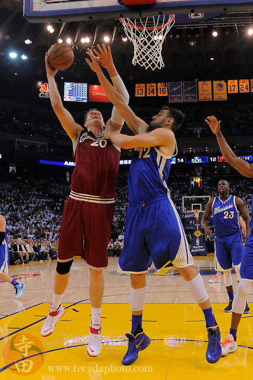 December 25, 2015; Oakland, CA, USA; Cleveland Cavaliers center Timofey Mozgov (20) shoots the basketball against Golden State Warriors center Andrew Bogut (12) during the first quarter in a NBA basketball game on Christmas at Oracle Arena. The Warriors defeated the Cavaliers 89-83.