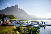 """Rio de Janeiro. BRAZIL.   2016 Olympic Rowing Regatta. Lagoa Stadium, GBR W8+, carry their boat from the water to the boat rack in the boat park  under the watch of, Christ the Redeemer, on the summit of Mount Corcovado, Rio de Janeiro,  Copacabana,  """"Olympic Summer Games""""<br /> Rodrigo de Freitas Lagoon, Lagoa.   Saturday  13/08/2016 <br /> <br /> [Mandatory Credit; Peter SPURRIER/Intersport Images]"""