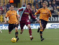 Photo: Kevin Poolman.<br />Wolverhampton Wanderers v Burnley. Coca Cola Championship. 17/02/2007. Kyle Lafferty of Burnley goes through the middle of Jackie McNamara (left) and Karl Henry of Wolves.