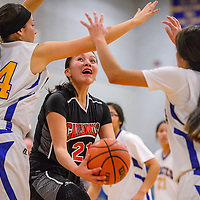 St. Michaels Cardinal Delila Nakaidanee (33) attempts to get a shot past Valley Sanders Pirate Mariah Soria (34) Saturday at Valley Sanders High School.