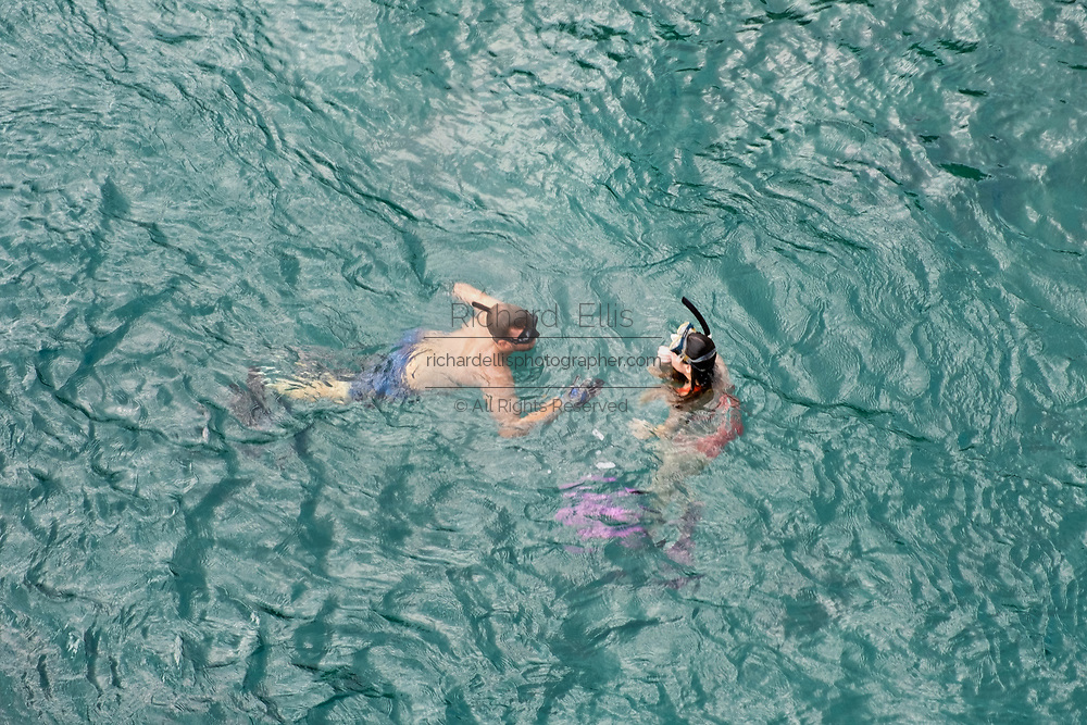 A couple snorkels in the Indian River under the South Beach Bridge at Jupiter Inlet in Jupiter, Florida.