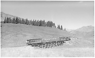 """Rocky Club railfan trip using RGS #74 with cabooses #0400 & #0401, three gondolas and business car B-21 """"Edna"""" northbound on Bridge 55-A.<br /> RGS  Lizard Head Pass, CO  Taken by Perry, Otto C. - 9/2/1951<br /> References to this trip can also be found in """"RGS Story Vol. I"""", p. 354 and """"RGS Story Vol. IV"""", p. 330.<br /> Thanks to Don Bergman for additional information."""