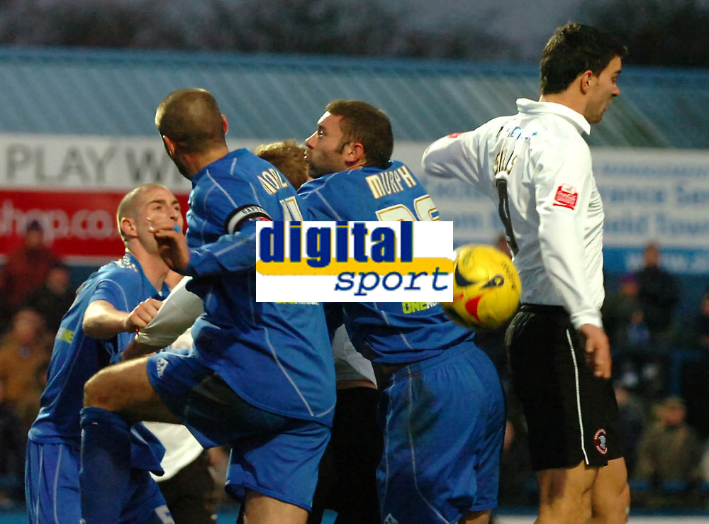 Photo: Paul Greenwood.<br />Macclesfield Town v Hereford United. Coca Cola League 2. 20/01/2007. Macclesfield's John Murphy, centre, and Hereford's Richard Rose, right, both miss the ball