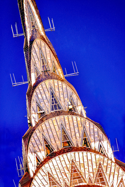 Morning sunlight glints golden on the stainless steel, Art Deco crown of the Chrysler Building