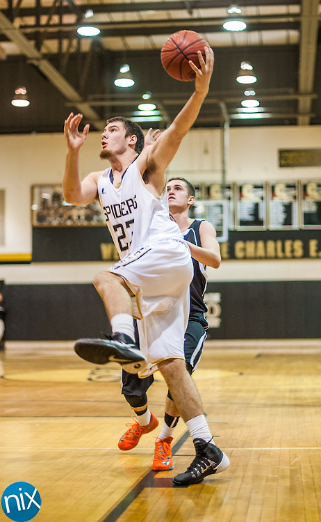Concord's Jerry Burk goes up for a shot against Northwest Cabarrus Tuesday night at Concord High School. Concord won the game 89-49.