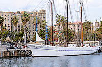 Spain, Barcelona. Port Vell is a waterfront harbour, built prior to the 1992 Barcelona Olympics. Sailship.