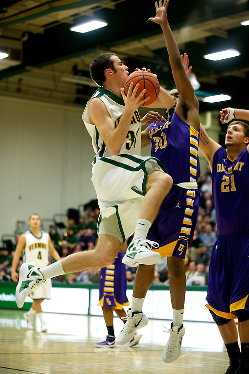 during the men's basketball game between the Albany Great Danes and the Vermont Catamounts at Patrick Gym on Thursday night January 19, 2012 in Burlington, Vermont.