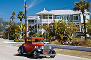 Vintage classic automobile, Chevrolet modelled, and luxury homes at vacation resort of Anna Maria Island, Florida, USA