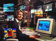 "Massachusetts's Institute of Technology (MIT), Cambridge Massachusetts. MIT Media Laboratory: Glorianna Davenport.  Davenport is working on interactive cinema and TV.  She is in an editing room surrounded by images from various sources.  She believes the future of news is ""an electronic personal storyteller that knows both you and the information personally.  The story is being told to you, for you.""  She wants to have a ""media bank,"" a collection of opinions and different points of view that can be accessed through video. MODEL RELEASED (1994)."