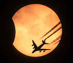 "***PREMIUM EXCLUSIVE*** Amazing Solar Eclipse photograph of an Airbus A380, the world's largest passenger plane, over the Massachusetts/New Hampshire border. Amazing Solar Eclipse photograph of an Airbus A380, the world's largest passenger plane, over the Massachusetts/New Hampshire border. The photograph of the Etihad Airlines plane was taken by Picture Boston owner Mark Garfinkel from the driveway of his Winthrop, MA, home using an improvised solar filter for his 800mm Canon lens. Mark, a news photographer on the Boston Herald, said: ""With some help from my neighbor Ron, my set up of a Canon 800mm lens and a large tripod was complete with seconds to spare before the solar show. ""Stuart Cahill, a colleague of mine at the Boston Herald newspaper where we are news photographers, had already made me an improvised solar filter for my large lens, and I had already obtained nerdy solar glasses for my eyes. ""I was amazed at how good the filter worked on my lens. I started to shoot photos every 4 minutes, or so, and was excited with what I had. There was one thing that I really wanted, though. I had expected that there would be an opportunity to get a high altitude airliner through the sun, or more correctly stated, through my view of the sun. I was not disappointed, though it came very late in the eclipse, and did just barely sneak into my view of the sun. I watched as one after another high altitude airliner, most flying from Europe to NYC, just missed the sun. I remember thinking that I wished air traffic controllers in Nashua,NH., would turn them just a little for me. It was getting late and clouds and haze were moving in front of my view of the sun. I noticed the flight tracking systems that I use, flightradar24 and planefinder, were showing an Airbus A380, the world's largest passenger plane, over the Massachusetts/NH border, and heading my way. The plane was at a flight level of 40,000′ and traveling at 446 knots. The Etihad Airlines plane was flying from Ab"