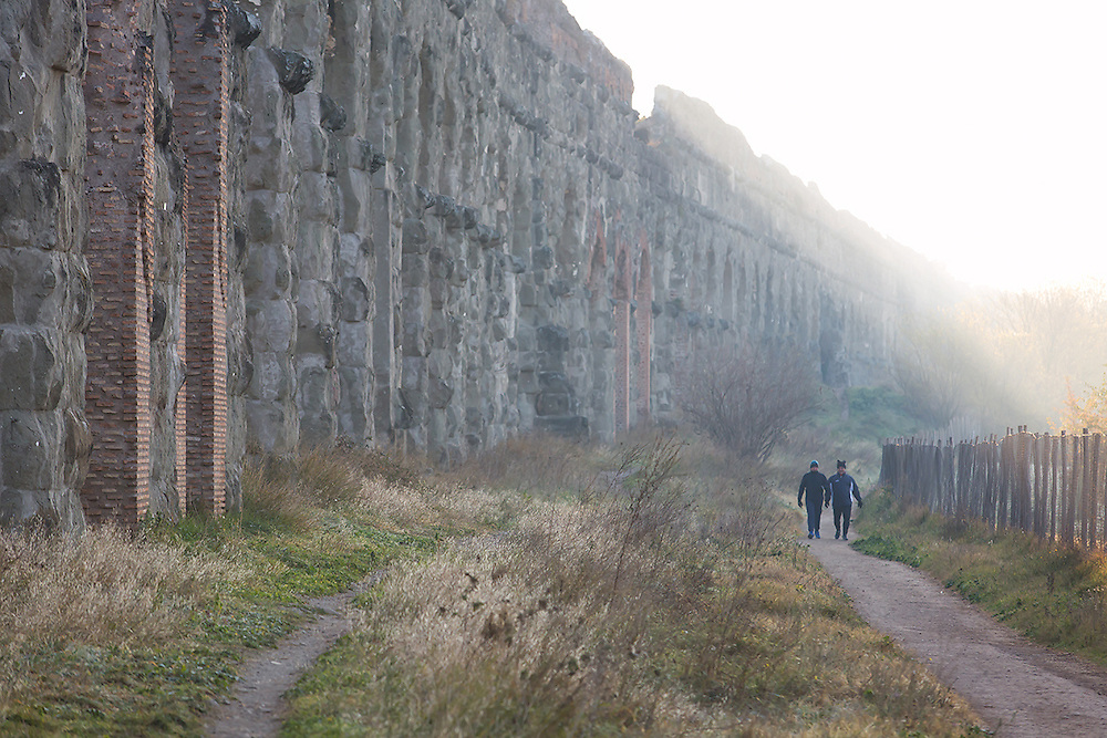 ROME -  Joggers near an aqueduct in the early morning fog at the Parco degli Acquedotti. COPYRIGHT JURRIAAN BROBBEL