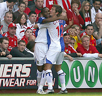 Fotball<br /> England <br /> Foto: Propaganda/Digitalsport<br /> NORWAY ONLY<br /> <br /> LIVERPOOL, ENGLAND - SATURDAY, OCTOBER 14th , 2006: Blackburn Rovers' Benni McCarthy celebrates scoring the opening goal against Liverpool with his team-mate Morten Gamst Pedersen during the Premiership match at Anfield.