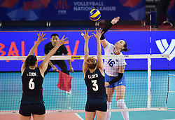 JIANGMEN, June 5, 2018  Irina Voronkova (R) of Russia spikes the ball during the match against the United States at FIVB Volleyball Nations League 2018 in Jiangmen City, south China's Guangdong Province, June 5, 2018. Team Russia lost the match 0-3. (Credit Image: © Liang Xu/Xinhua via ZUMA Wire)