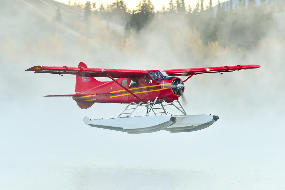 An Alpine Aviation DHC-2 Beaver climbs through the mist at Schwatka Lake in Whitehorse, Yukon