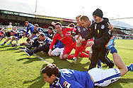 Rochdale players celebrate promotion to Sky Bet League One by diving in front of their supporters after the match. Skybet football league two match, Newport county v Rochdale at Rodney Parade in Newport, South Wales on Saturday 3rd May 2014.<br /> pic by Mark Hawkins, Andrew Orchard sports photography.