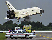 KENNEDY SPACE CENTER,FL- SHUTTLE- The Space Shuttle Atlantis comes in for a landing at the Kennedy Space Center Saturday morning as family members and rescue crew watch along the runway.  (staff/scott iskowitz)