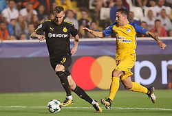 NICOSIA, Oct. 18, 2017  Bortussia Dortmund's Andriy Yarmolenko (L) vies for the ball during the 2017-2018 Champions League match against Apoel in Nicosia, Cyprus, Oct. 17, 2017. The match tied 1-1. (Credit Image: © Sakis Savvides/Xinhua via ZUMA Wire)