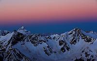 Russia, Caucasus, mountain range before sunrise, red sky, seen from Elbrus.