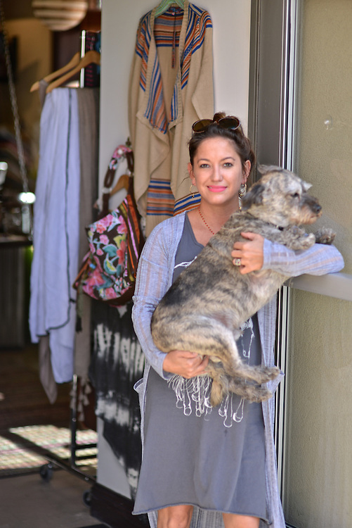 Owner of Allie M. Designs with her dog.