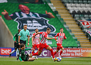 Plymouth Argyle midfielder Conor Grant (15) attempt sliding tackle  on Sunderland Forward Jack Diamond (21) during the EFL Sky Bet League 1 match between Plymouth Argyle and Sunderland at Home Park, Plymouth, England on 1 May 2021.