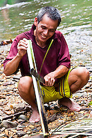Preparing the bamboo so it can be used to cook chicken and sticky rice.