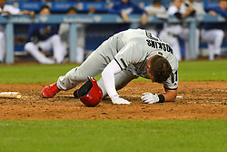 May 28, 2018 - Los Angeles, CA, U.S. - LOS ANGELES, CA - MAY 28: Philadelphia Phillies left fielder Rhys Hoskins (17) lays on the ground after fouling a pitch off his face during a MLB game between the Philadelphia Phillies and the Los Angeles Dodgers on Memorial Day, May 28, 2018 at Dodger Stadium in Los Angeles, CA. (Photo by Brian Rothmuller/Icon Sportswire) (Credit Image: © Brian Rothmuller/Icon SMI via ZUMA Press)