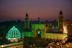 November 20, 2018 - Lahore, Punjab, Pakistan - An illuminated view of historical Wazir Khan Mosque colorful lights in connection with 12th Rabi-ul-Awwal in the Muslim lunar calendar (Eid-e-Milad-un-Nabi) the birthday celebrations  of Holy Prophet Muhammad (PBUH) in Lahore. Eid-e-Milad-un-Nabi holiday celebrating the birthday of Islam's prophet, Muhammad, born in the year 570, Thousands of Pakistani Muslims will take part on Wednesday in religious processions, ceremonies and distributing free meals among the poor. (Credit Image: © Rana Sajid Hussain/Pacific Press via ZUMA Wire)