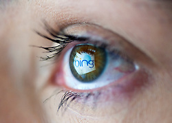Microsoft's Bing search engine website logo reflected in womans eye from computer screen