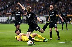 Eintracht Frankfurt's Martin Hinteregger kicks the ball as Chelsea's Olivier Giroud goes down during the UEFA Europa League Semi final, first leg match at The Frankfurt Stadion, Frankfurt.