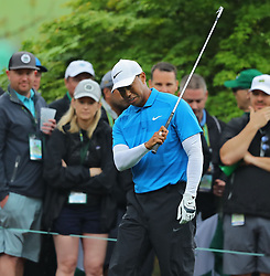 April 7, 2018 - Augusta, Georgia, U.S. - TIGER WOODS is unhappy with his fairway shot on the 8th hole during the third round of the Masters Tournament on Saturday, at Augusta National Golf Club. (Credit Image: © Curtis Compton/TNS via ZUMA Wire)