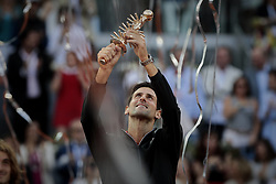 May 12, 2019 - Madrid, Madrid, Spain - Novak Djokovic from Serbia seen celebrating with his trophy during the Mutua Madrid Open Masters final match against Stefanos Tsitsipas from Greece on day eight at Caja Magica in Madrid..Novak Djokovic beats Stefanos Tsitsipas. (Credit Image: © Legan P. Mace/SOPA Images via ZUMA Wire)