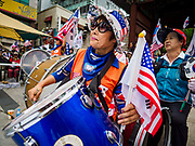 09 JUNE 2018 - SEOUL, SOUTH KOREA: A woman plays a drum during a pro-American rally in downtown Seoul. Participants said they wanted to thank the US for supporting South Korea and they hope the US will continue to support South Korea. Many were also opposed to ongoing negotiations with North Korea because they don't think Kim Jong-un can be trusted to denuclearize or to not attack South Korea.    PHOTO BY JACK KURTZ