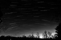 Winter Nighttime Sky Over New Jersey. Composite star trail image 05:00-05:29) taken with a Nikon D810a camera and 19 mm f/4 PC-E lens (ISO 400, 19 mm, f/8, 120 sec). Raw images processed with Capture One Pro and the composite created with Photoshop CC (statistics, maximum). Conversion to B&W with Capture One Pro.