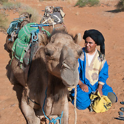 Berber Arab man and his camels in the Sahara, Morocco