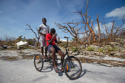 Juvence Davlmay, 11, left, and cousin Rodney Dorvilus,14, look at the destruction from Hurricane Dorian at Marsh Harbour in Great Abaco Island, Bahamas on Wednesday, September 4, 2019. Photo by Al Diaz/Miami Herald/TNS/ABACAPRESS.COM